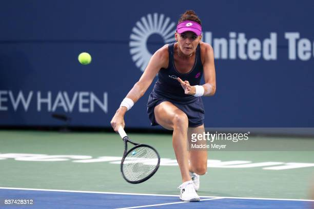 Agnieszka Radwanska of Poland returns a shot to Eugenie Bouchard of Canada during Day 5 of the Connecticut Open at Connecticut Tennis Center at Yale...