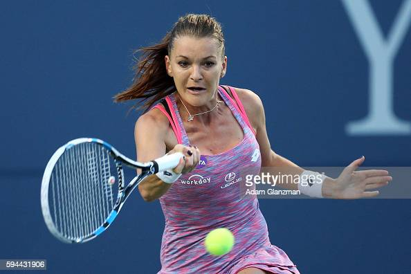 Agnieszka Radwanska of Poland returns a shot to Jelena Ostapenko of Latvia during her mach on day 3 of the Connecticut Open at the Connecticut Tennis...