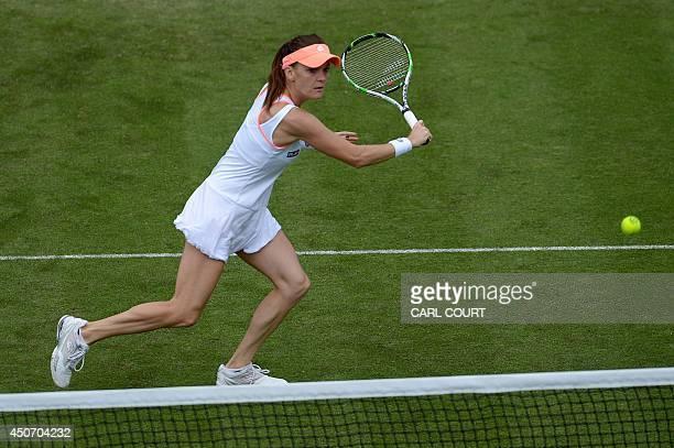 Agnieszka Radwanska of Poland returns against Anastasia Pavlyuchenkova of Russia during their womens singles first round match on the third day of...