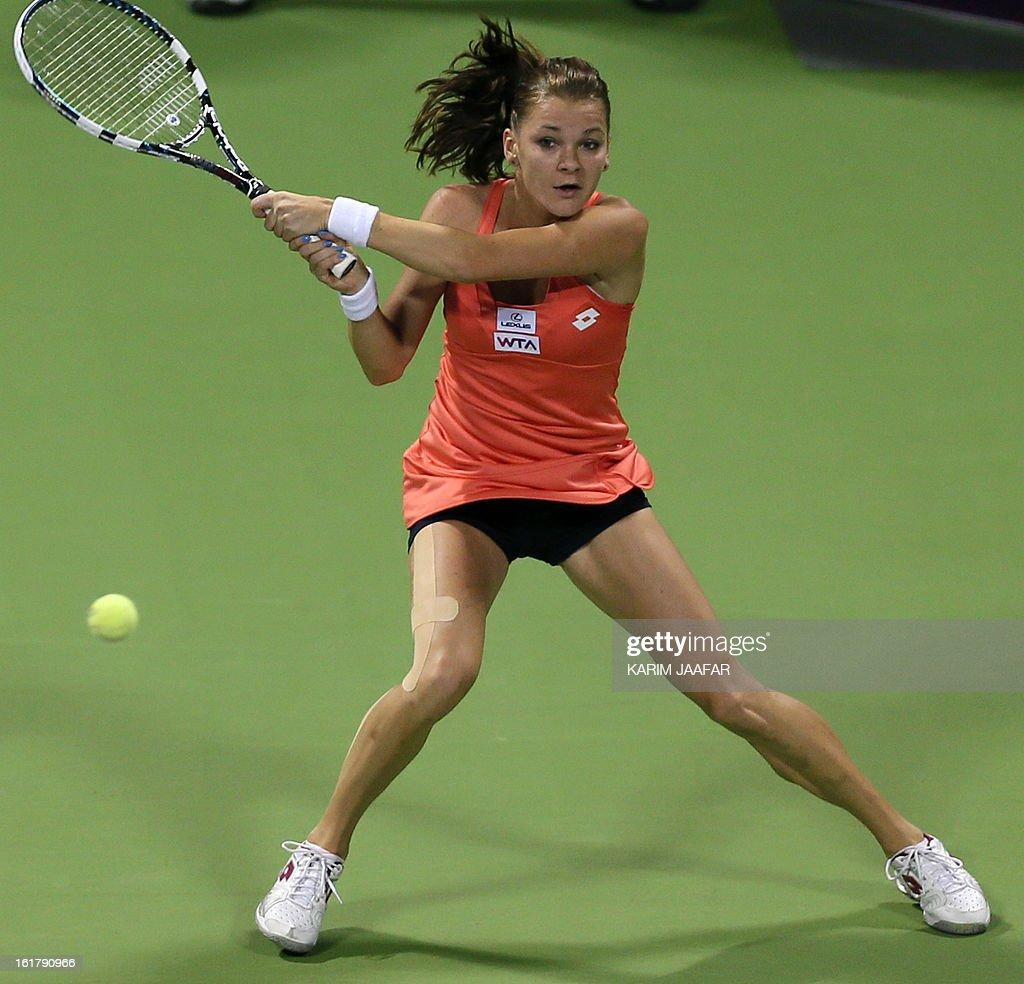 Agnieszka Radwanska of Poland returns the ball to Belarus Victoria Azarenka during their WTA Qatar Open semi-final tennis match on February 16, 2013 in the Qatari capital, Doha.
