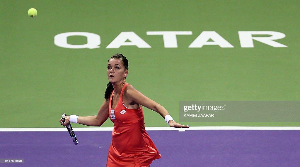 Agnieszka Radwanska of Poland returns the ball to Belarus Victoria Azarenka during their WTA Qatar Open semi-final tennis match on February 16, 2013 in the Qatari capital, Doha. Azarenka won 6-3, 6-3. AFP PHOTO / AL-WATAN DOHA / KARIM JAAFAR == QATAR OUT ==