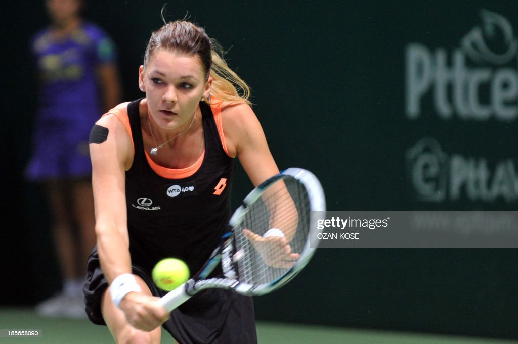 Agnieszka Radwanska of Poland returns the ball to Serena Williams of the US on October 23, 2013 during a WTA Championships tennis match in Istanbul.
