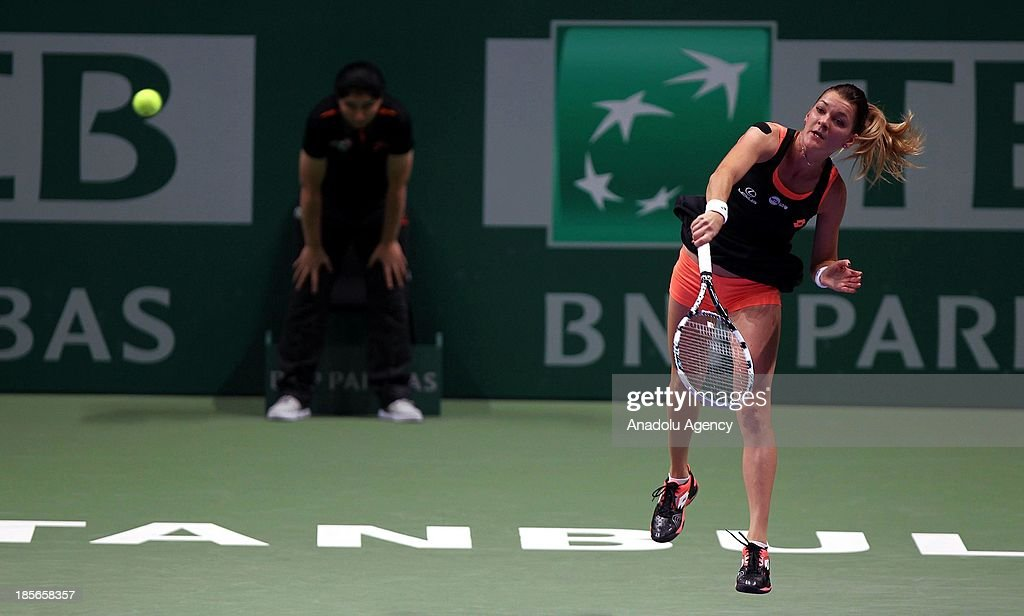 Agnieszka Radwanska of Poland returns the ball to Serena Williams of the US during their TEB BNP Paribas WTA Championships match at Sinan Erdem Dome on October 23, 2013 in Istanbul, Turkey.