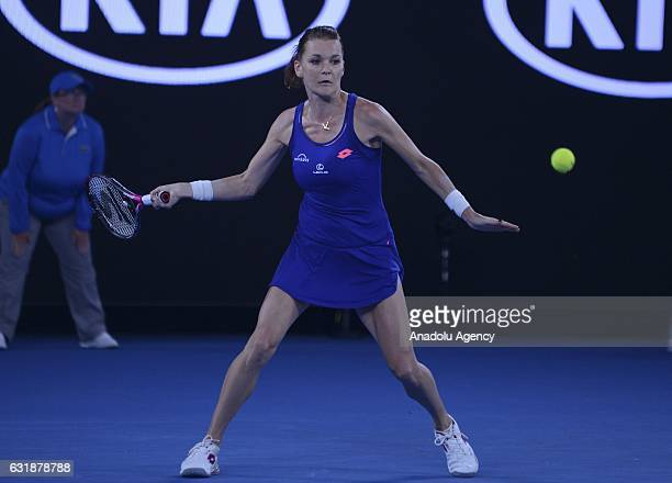 Agnieszka Radwanska of Poland returns the ball to Tsvetana Pironkova of Bulgaria during their women's singles first round match of the Australian...