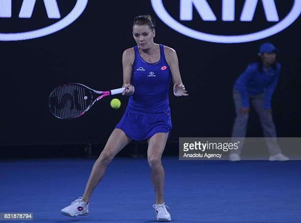 Agnieszka Radwanska of Poland returns the ball to Tsvetana Pironkova of Bulgaria during their women's singles first round match of the Australian...