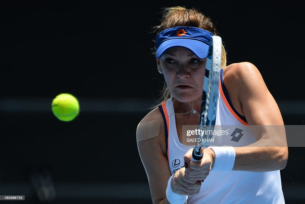 Agnieszka Radwanska of Poland returns to Anastasia Pavlyuchenkova of Russia during their women's singles match on day six of the 2014 Australian Open tennis tournament in Melbourne on January 18, 2014.
