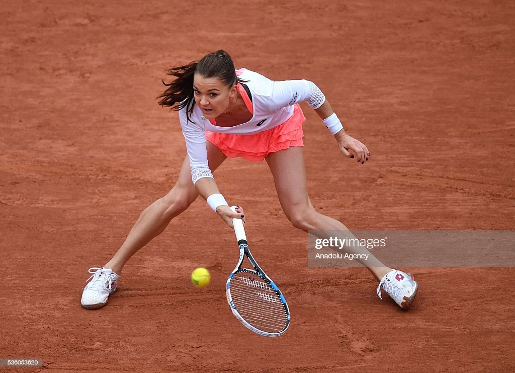 Agnieszka Radwanska of Poland returns to Tsvetana Pironkova of Bulgaria during the women's single fourth round match at the French Open tennis tournament at Roland Garros Stadium in Paris, France on May 31, 2016.