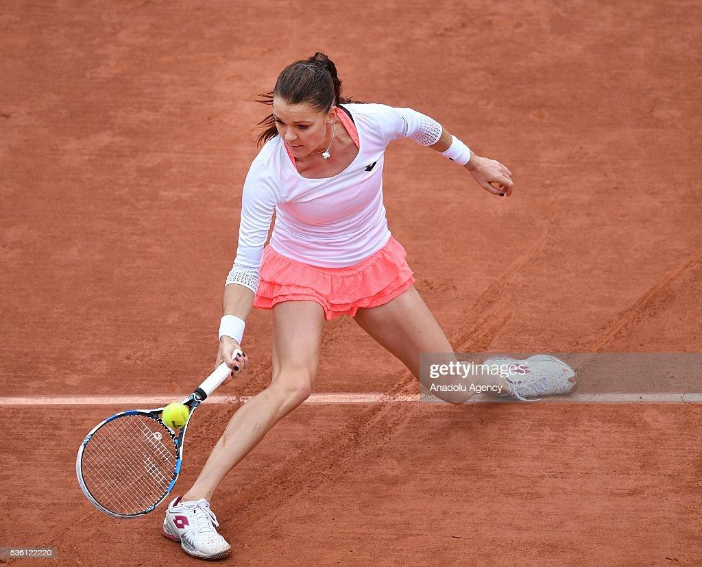 Agnieszka Radwanska of Poland returns to Tsvetana Pironkova of Bulgaria during the women's single fourth round match at the French Open tennis tournament at Roland Garros Stadium in Paris, France on May 31, 2016.