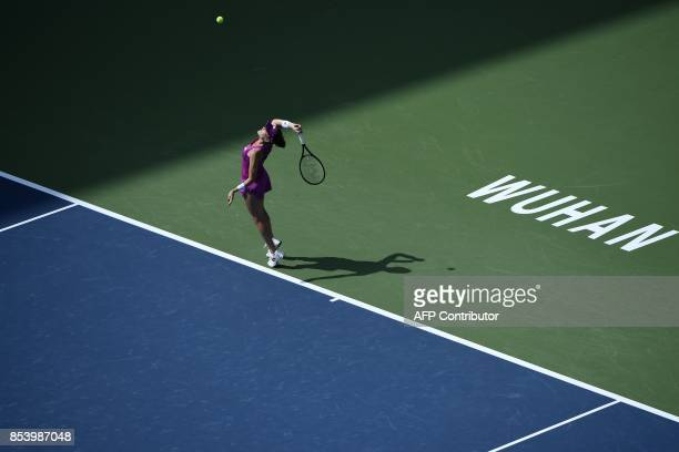 TOPSHOT Agnieszka Radwanska of Poland serves against Julia Goerges of Germany during their second round women's singles match at the WTA Wuhan Open...