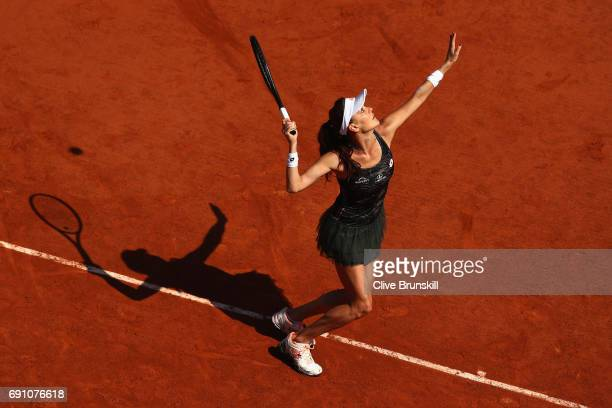 Agnieszka Radwanska of Poland serves during the ladies singles second round match against Alsion Van Uytvanck of Belgium on day five of the 2017...