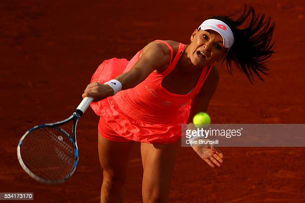 Agnieszka Radwanska of Poland serves during the Women's Singles second round match against Caroline Garcia of France on day four of the 2016 French...