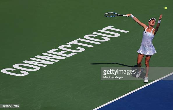 Agnieszka Radwanska of Poland serves to Alize Cornet of France on Day 3 of the Connecticut Open at Connecticut Tennis Center at Yale on August 26...