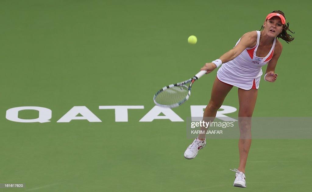 Agnieszka Radwanska of Poland serves to Anastasia Rodionova of Australia during their match on the third day of the WTA Qatar Open in the capital Doha, on February 13, 2013.