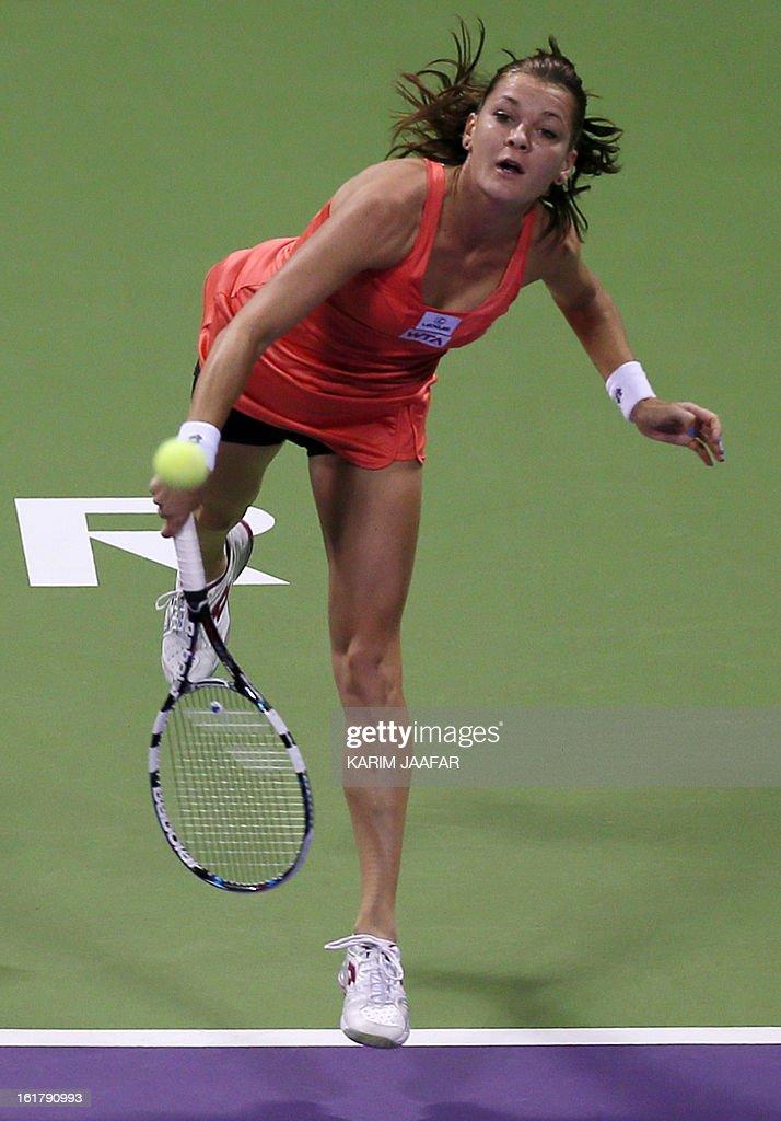Agnieszka Radwanska of Poland serves to Belarus Victoria Azarenka during their WTA Qatar Open semi-final tennis match on February 16, 2013 in the Qatari capital, Doha.