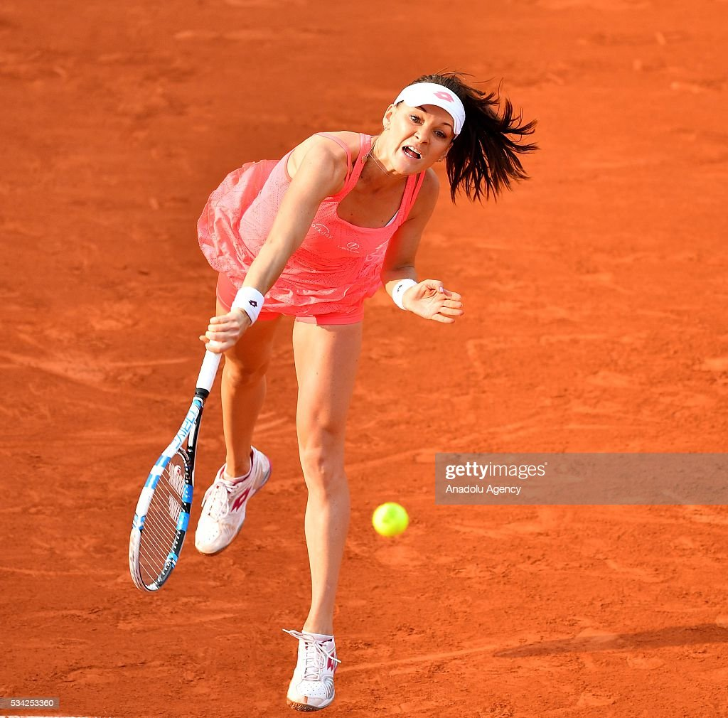 Agnieszka Radwanska of Poland serves to Caroline Garcia (not seen) of France during their women's single second round at the French Open tennis tournament at Roland Garros in Paris, France on May 25, 2016.