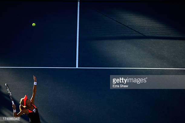 Agnieszka Radwanska of Poland serves to Jamie Hampton during their semifinal match on Day 6 of the Bank of the West Classic at Stanford University...