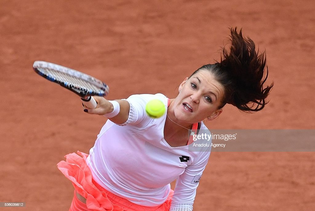 Agnieszka Radwanska of Poland serves to Tsvetana Pironkova of Bulgaria during the women's single fourth round match at the French Open tennis tournament at Roland Garros Stadium in Paris, France on May 31, 2016.