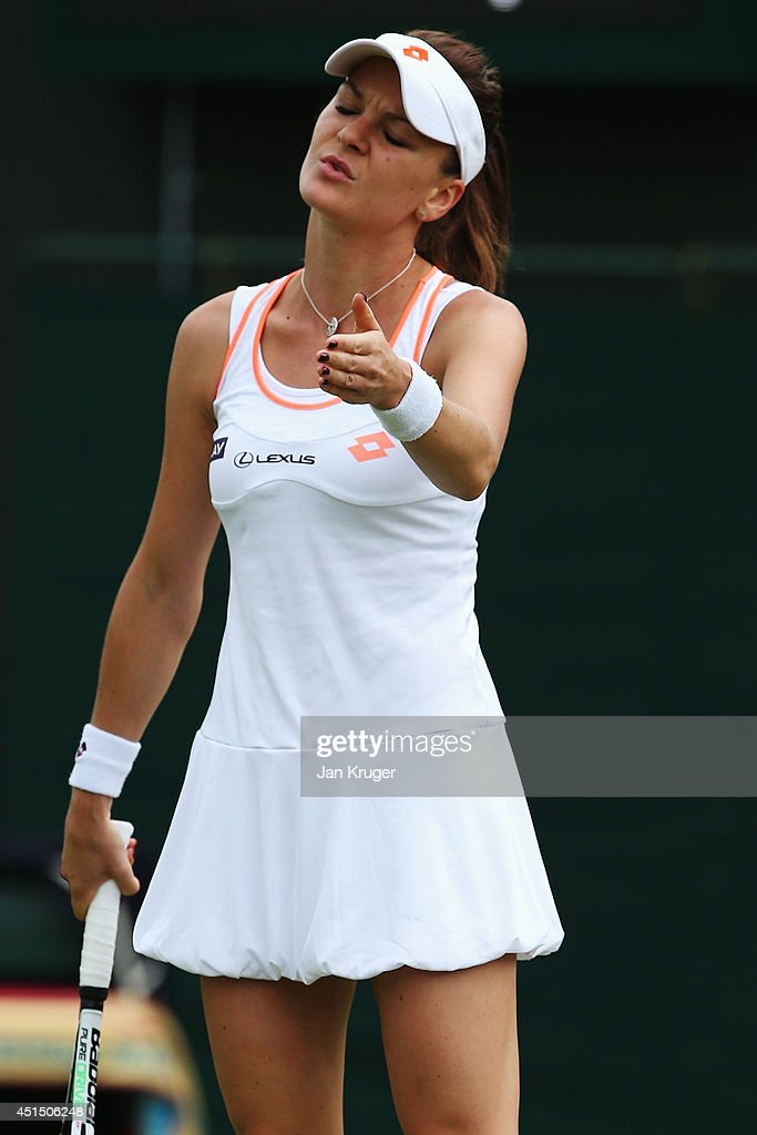Agnieszka Radwanska of Poland stands dejected during her Ladies' Singles fourth round match against Ekaterina Makarova of Russia on day seven of the...