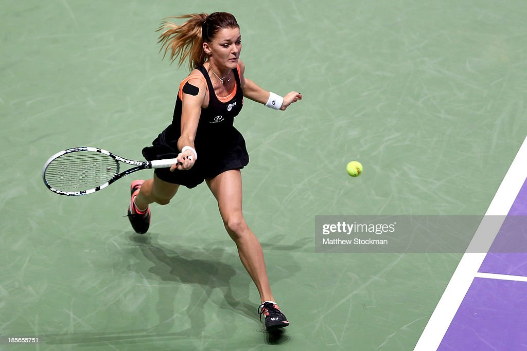 <a gi-track='captionPersonalityLinkClicked' href=/galleries/search?phrase=Agnieszka+Radwanska&family=editorial&specificpeople=579516 ng-click='$event.stopPropagation()'>Agnieszka Radwanska</a> of Poland stretches for a ball while playing Serena Williams of the United States during day two of the TEB BNP Paribas WTA Championships at the Sinan Erdem Dome on October 23, 2013 in Istanbul, Turkey.