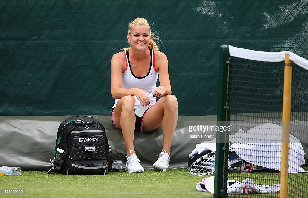 <a gi-track='captionPersonalityLinkClicked' href=/galleries/search?phrase=Agnieszka+Radwanska&family=editorial&specificpeople=579516 ng-click='$event.stopPropagation()'>Agnieszka Radwanska</a> of Poland takes a break in a practice session during previews for Wimbledon Championships at Wimbledon on June 23, 2013 in London, England.