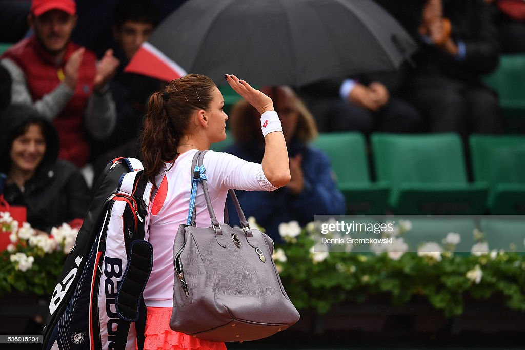 <a gi-track='captionPersonalityLinkClicked' href=/galleries/search?phrase=Agnieszka+Radwanska&family=editorial&specificpeople=579516 ng-click='$event.stopPropagation()'>Agnieszka Radwanska</a> of Poland walks off the court following defeat during the Ladies Singles fourth round match against Tsvetana Pironkova of Bulgaria on day ten of the 2016 French Open at Roland Garros on May 31, 2016 in Paris, France.
