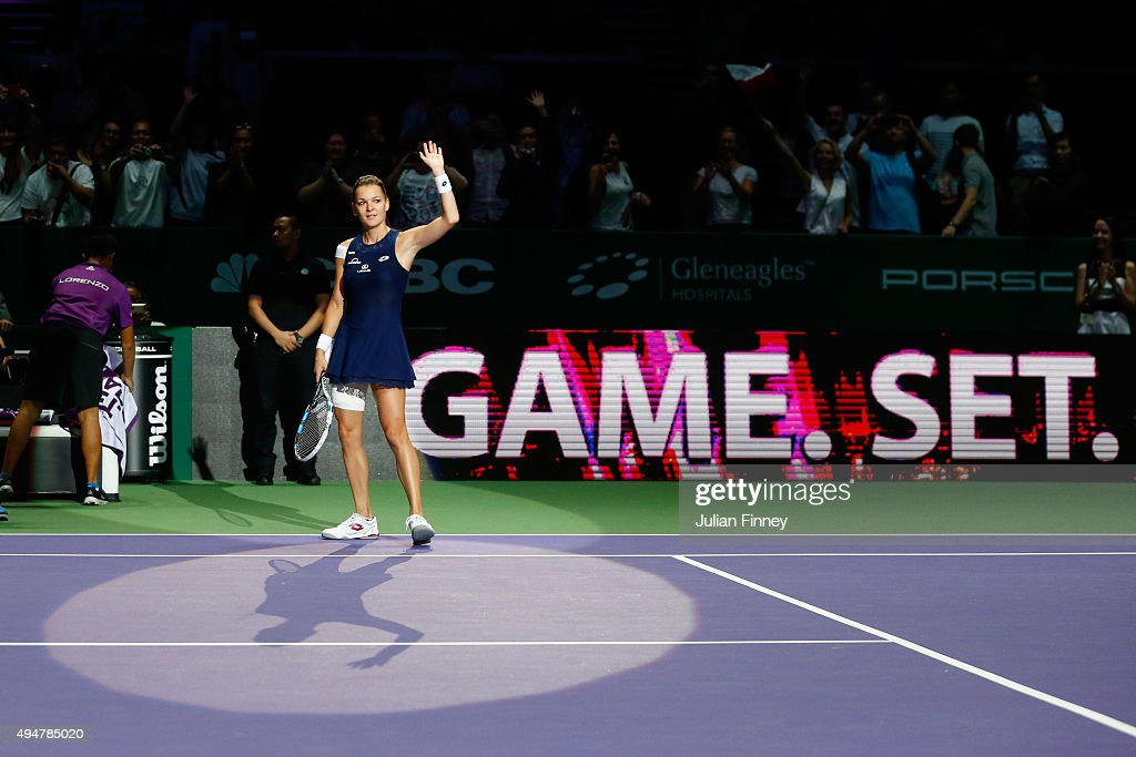Agnieszka Radwanska of Poland waves to the crowd after defeating Simona Halep of Romania in a round robin match during the BNP Paribas WTA Finals at Singapore Sports Hub on October 29, 2015 in Singapore.
