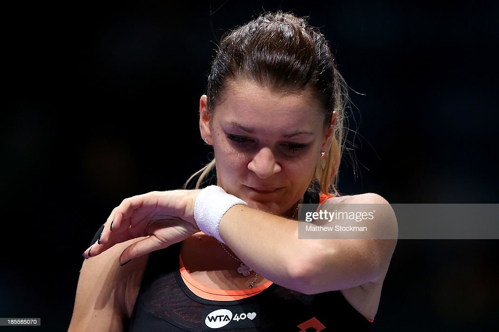 <a gi-track='captionPersonalityLinkClicked' href=/galleries/search?phrase=Agnieszka+Radwanska&family=editorial&specificpeople=579516 ng-click='$event.stopPropagation()'>Agnieszka Radwanska</a> of Poland wipes her face between points while playing Petra Kvitova of Czech Republic during day one of the TEB BNP Paribas WTA Championships at the Sinan Erdem Dome on October 22, 2013 in Istanbul, Turkey.