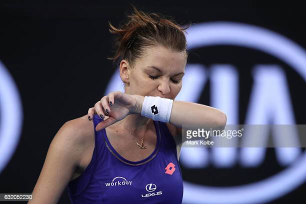 Agnieszka Radwanska of Poland wipes her face in her second round match against Mirjana LucicBaroni of Croatia on day four of the 2017 Australian Open...