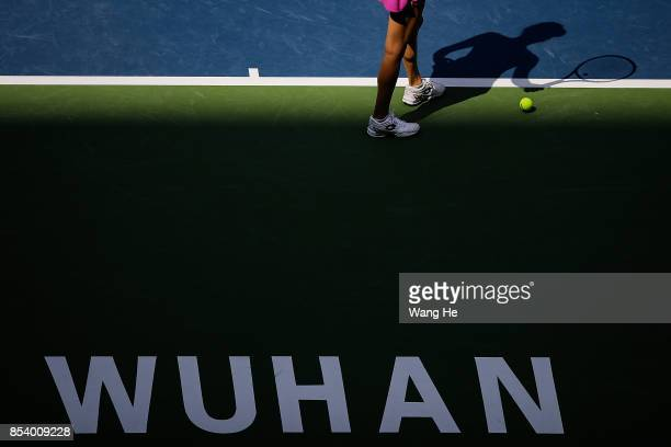 Agnieszka Redwanska of Poland serves against Julia Goerges Germany on Day 3 of 2017 Dongfeng Motor Wuhan Open at Optics Valley International Tennis...