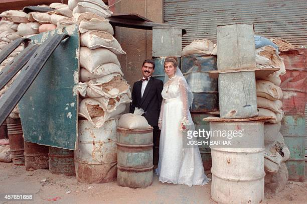 Agop Abousefian a Lebaneseborn Christian Armenian and Angela Avetisian from Yerevan Soviet Union pose during their wedding in front of their house in...