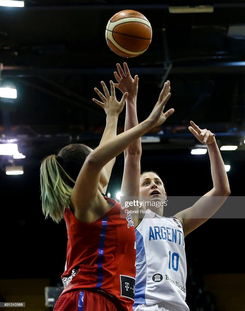 Agostina Burani of Argentina fights for the ball with Dayshalee Salam of Puerto Rico during a match between Argentina and Puerto Rico as part of the FIBA Women's AmeriCup Semi Final at Obras Sanitarias Stadium on August 12, 2017 in Buenos Aires, Argentina.