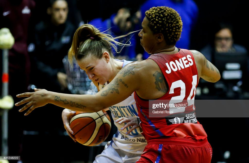 Agostina Burani of Argentina fights for the ball with Yolanda Jones of Puerto Rico during a match between Argentina and Puerto Rico as part of the FIBA Women's AmeriCup Semi Final at Obras Sanitarias Stadium on August 12, 2017 in Buenos Aires, Argentina.