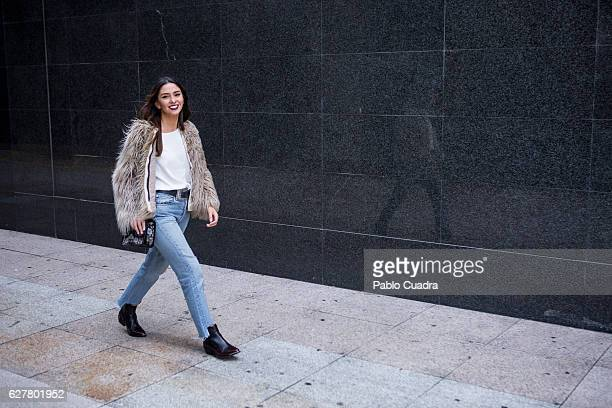 Agostina Saracco wears Zara blouse and Jacket Levi's Jeans Asos boots and Parfois handbag on December 2 2016 in Madrid Spain