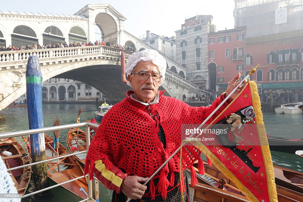 Agostino Conte dressed as 'Befana' wins the traditional Epiphany Boat Race on January 6 2013 in Venice Italy In Italy Epiphany is celebrated on...