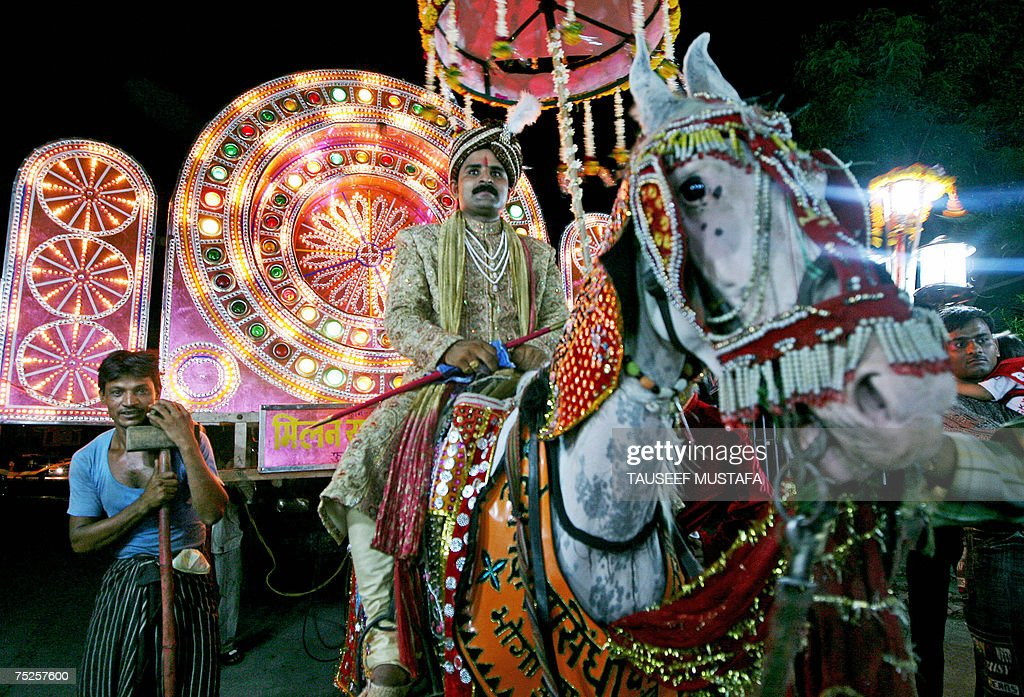 An Indian groom rides a horse on his way to his bride's house for their wedding ceremony in Agra late 06 July 2007 In traditions originating in rural...