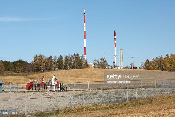 Agricultural Land With Red And White Gas Plant