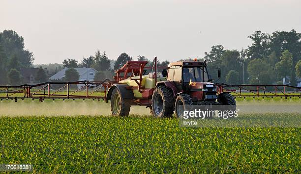 Agricultural machinery spraying the crops with pesticides in springtime, Belgium.