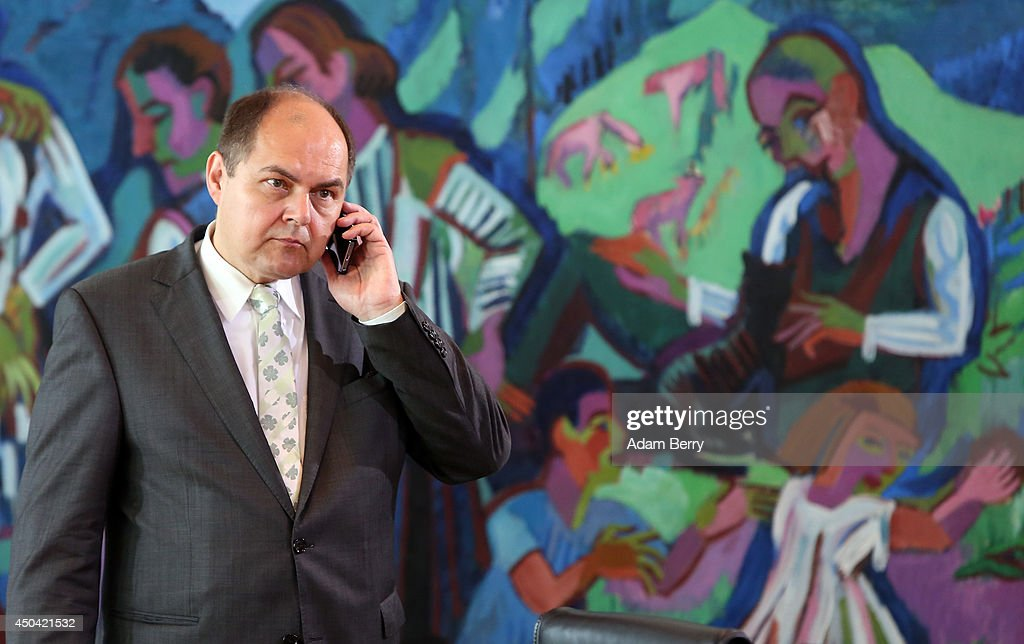 Agriculture and Consumer Protection Minister Christian Schmidt (CSU) uses his mobile phone as he arrives for the weekly German federal Cabinet meeting on June 11, 2014 in Berlin, Germany. High on the meeting's agenda was discussion over the country's arms export policies.