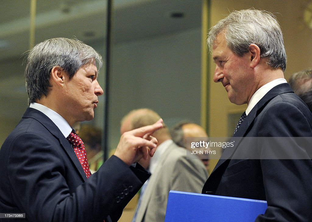 EU Agriculture and Rural Development commissioner Dacian Ciolos speaks with Britains Secretary of State for Environment Food and Rural Affairs Owen...