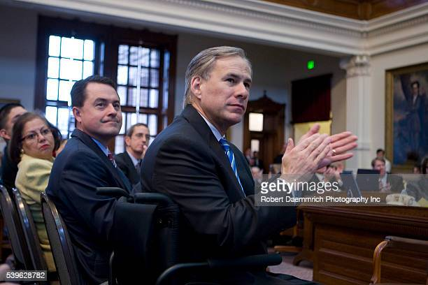Agriculture Commissioner Todd Staples and Attorney General Greg Abbott applaud the State of the State speech by Governor Rick Perry before a joint...