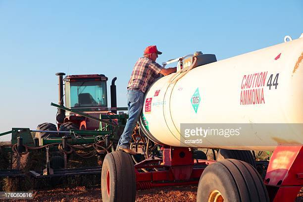 Agriculture: Farmer with Fertilizer Tank and tractor