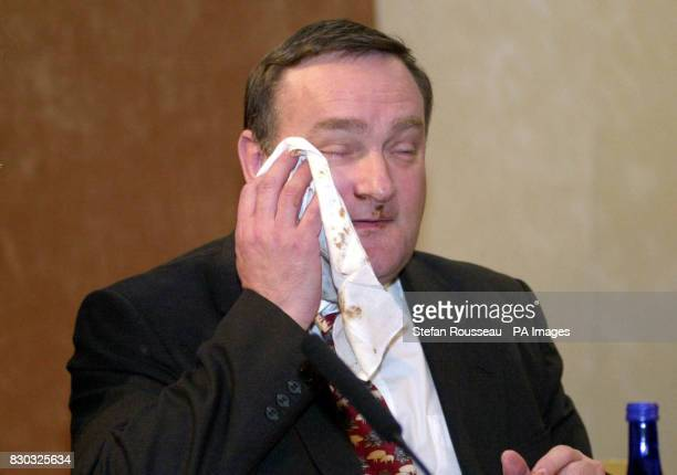 Agriculture Minister Nick Brown after a woman threw a chocolate cake into his face at the National Farmers Union Conference in London