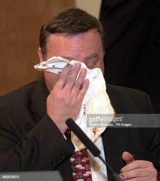 Agriculture Minister Nick Brown wipes his face after a woman threw a chocolate cake at him at the National Farmers Union Conference in London