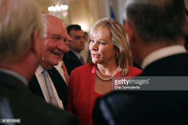 Agriculture Secretary Sonny Perdue visits with Oklahoma Governor Mary Fallin during a Made in America product showcase in the East Room at the White...