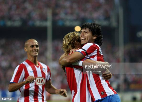 Aguero of Atletico Madrid celebrates his opening goal with his teammates Diego Forlan and Mariano Pernia during the UEFA Champions League third...