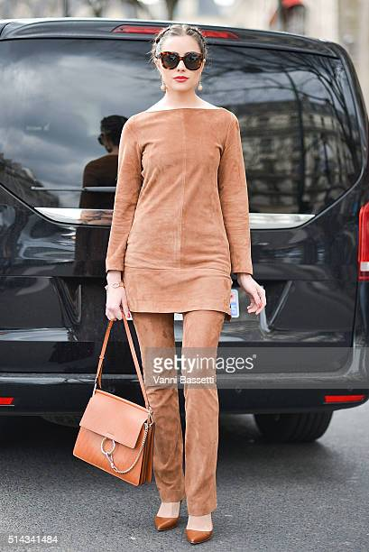Aguest poses with a Chloe bag after the Vanessa Seward show at the Thatre du Chatelet during Paris Fashion Week FW 16/17 on March 8 2016 in Paris...