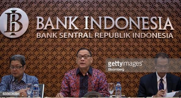 Agus Martowardojo governor of Bank Indonesia center speaks as Erwin Riyanto deputy governor of Bank Indonesia left and Sugeng Sugeng deputy governor...