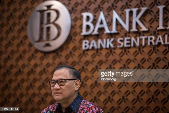 Agus Martowardojo governor of Bank Indonesia pauses during a news conference following the central bank's rate decision meeting in Jakarta Indonesia...