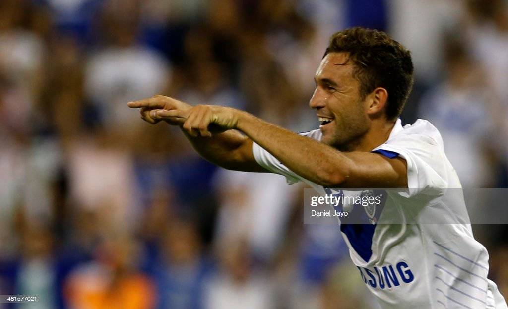 Agustin Allione of Velez Sarsfield celebrates after scoring the fourth goal against Gimnasia y Esgrima La Plata during a match between Velez Sarsfield and Gimnasia y Esgrima La Plata as part of 10th round of Torneo Final 2014 at Jose Amalfitani Stadium on March 29, 2014 in Buenos Aires, Argentina.