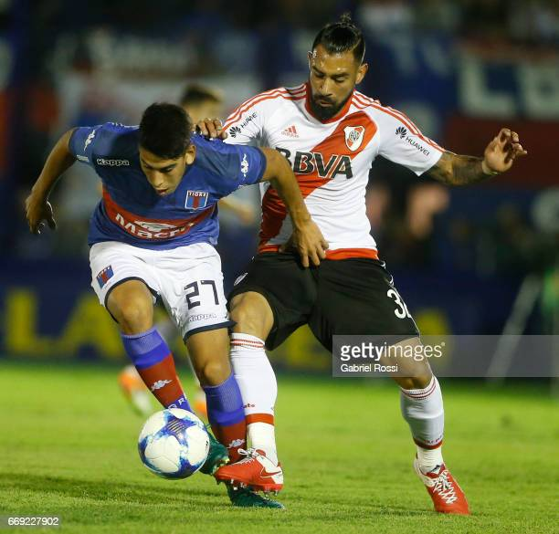 Agustin Cardozo of Tigre fights for the ball with Ariel Rojas of River Plate during a match between Tigre and River Plate as part of Torneo Primera...